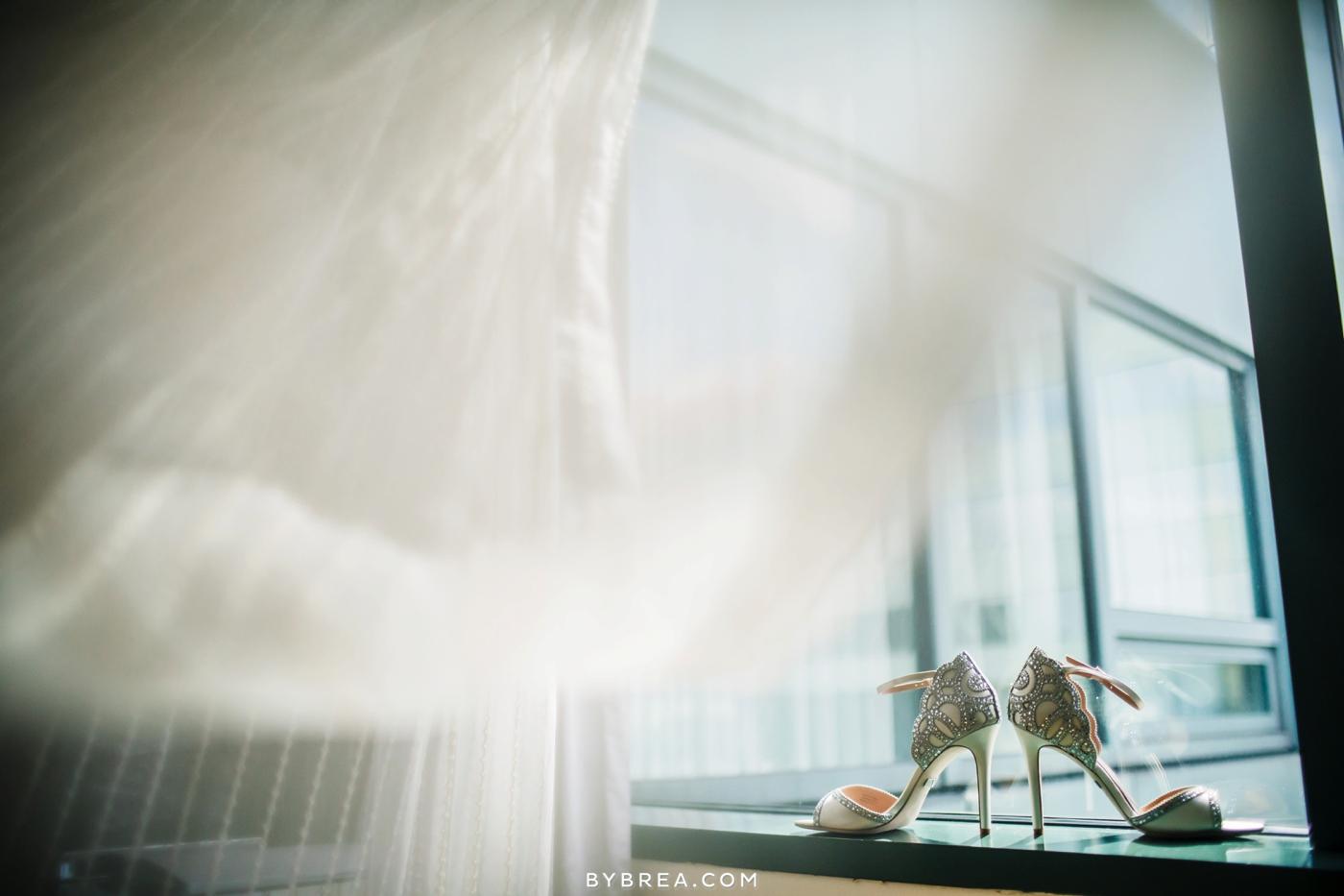 Baltimore wedding detail photo bridal shoes heels in window