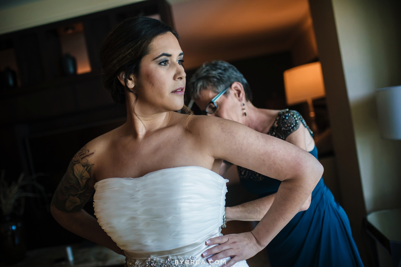 Baltimore wedding mother helping bride with dress by J&B Bridal