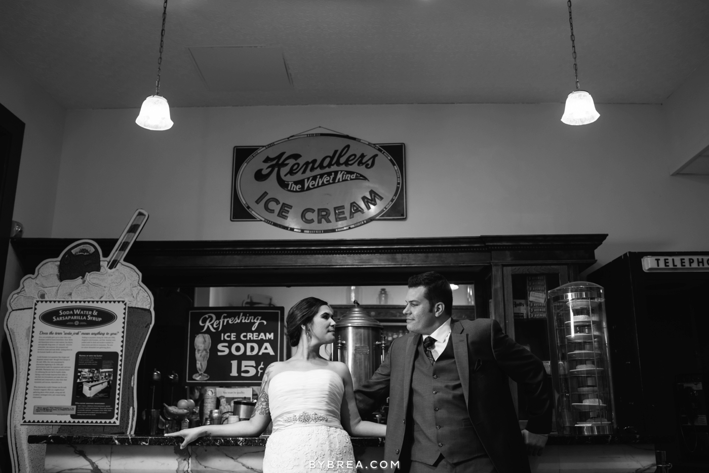 Baltimore wedding photo bride and groom at the soda fountain