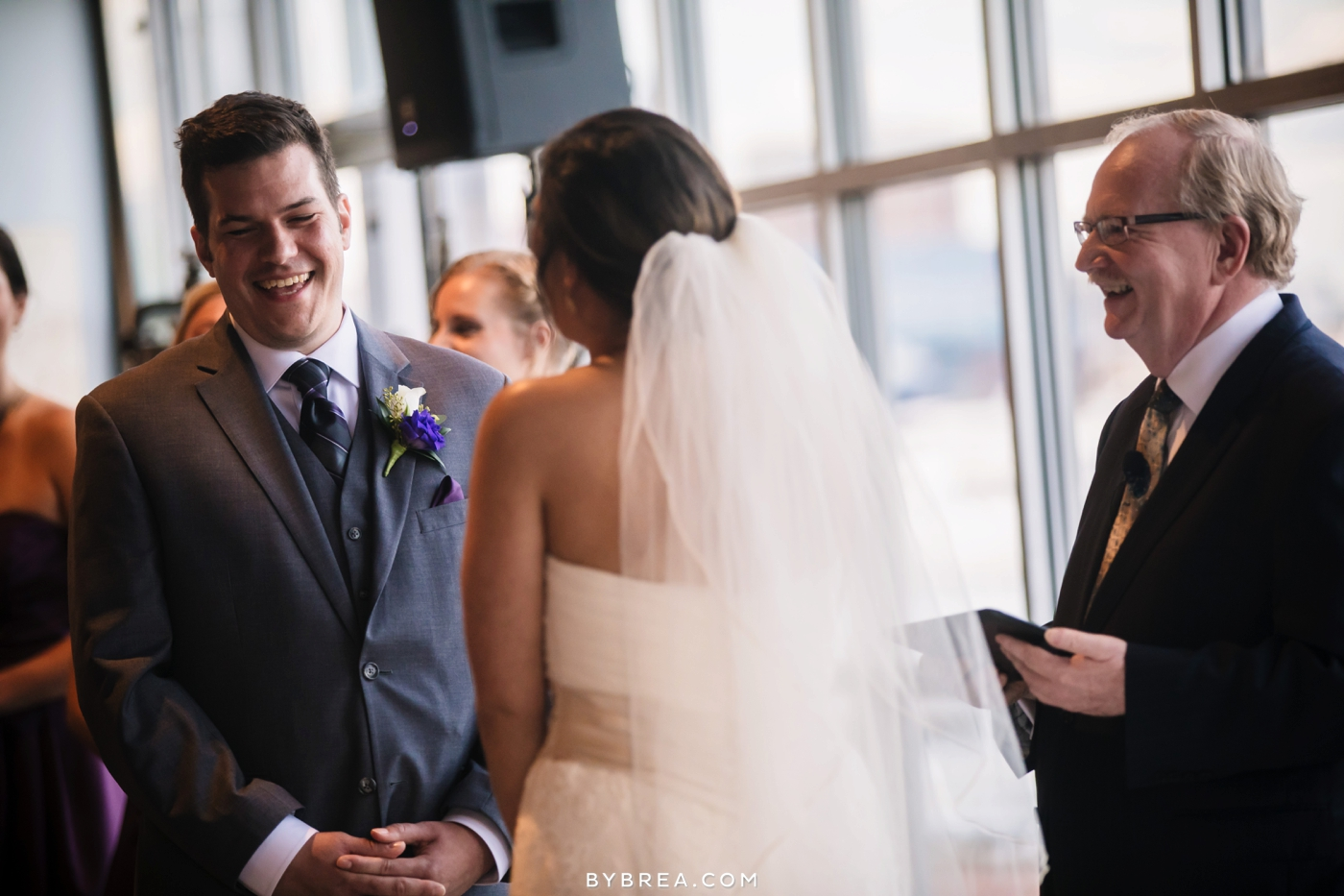 Baltimore wedding photo groom laughing during ceremony