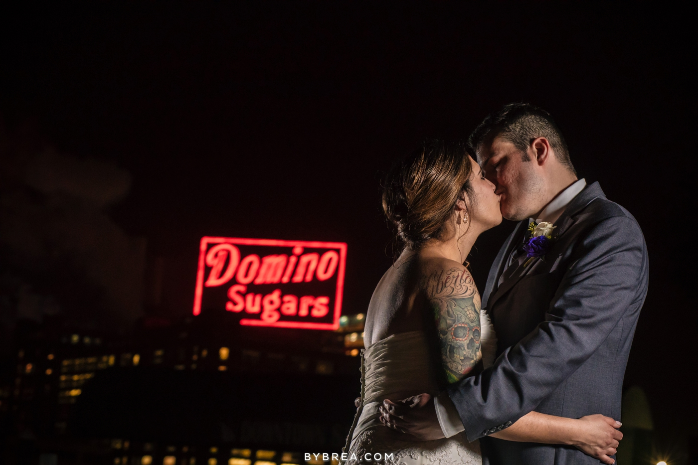 Baltimore wedding night photo bride and groom kissing