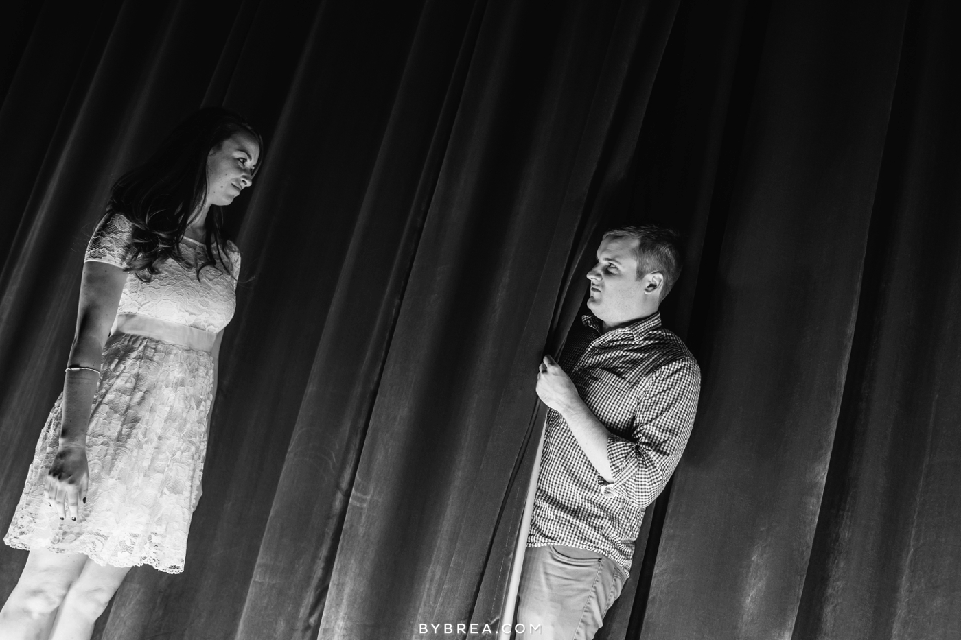 Senator theater engagement man peeks from behind curtain