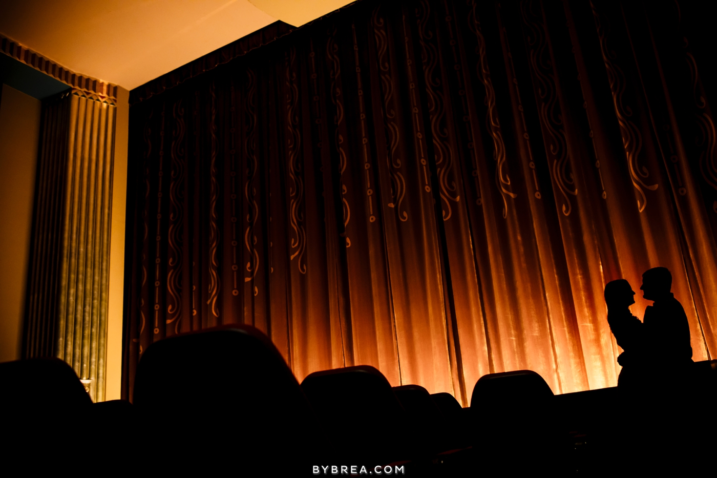Senator Theater engagement silhouette couple and theater curtain