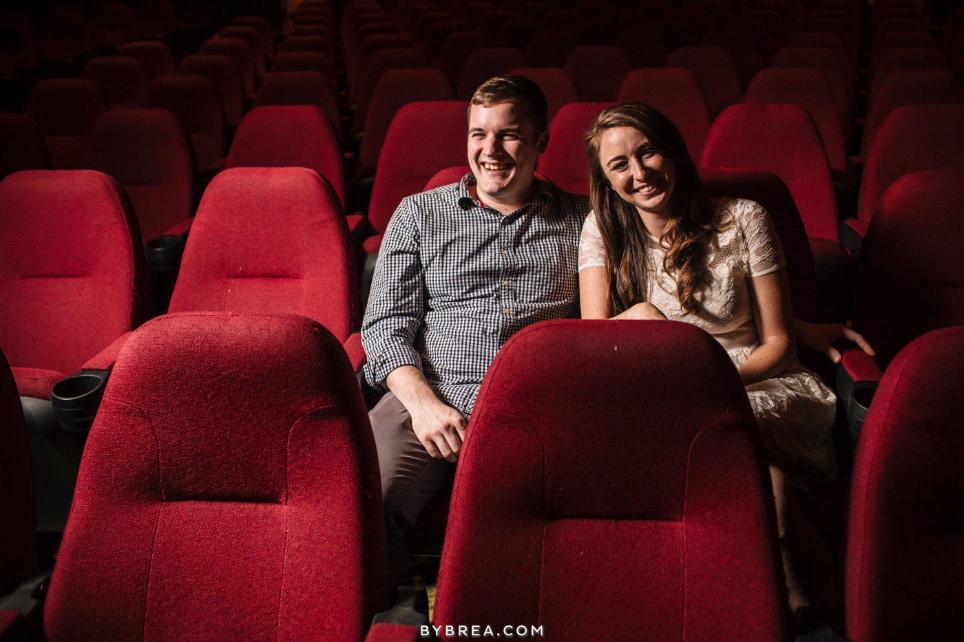 Senator Theater engagement couple in movie seats laughing