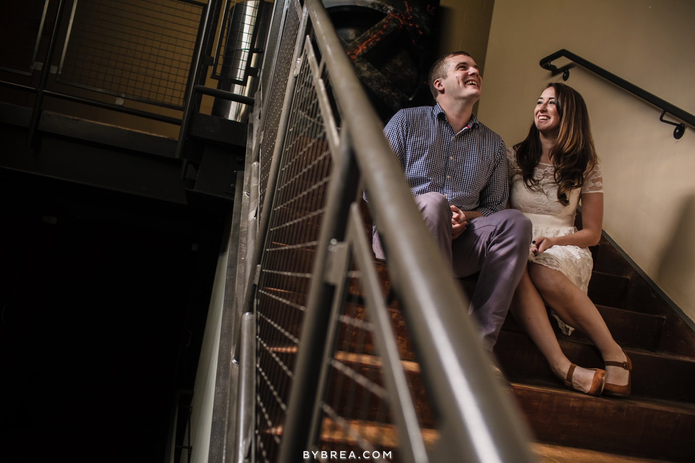 Senator Theater engagement couple sitting on the stairs