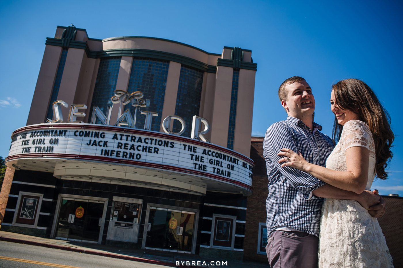 Senator Theater engagement couple standing outside of theater