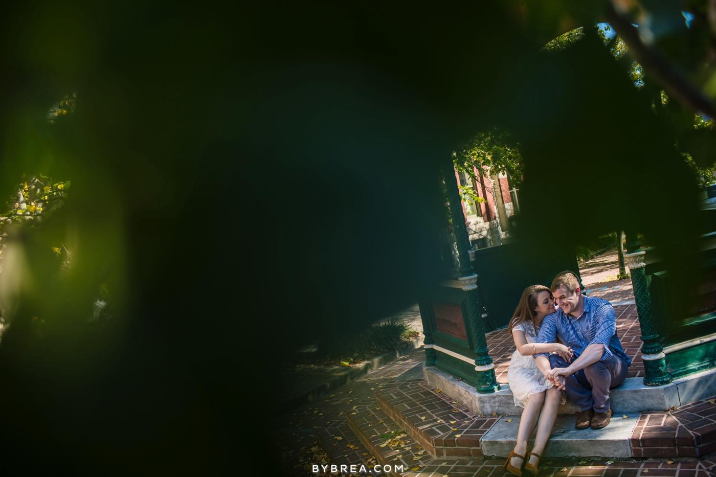 Baltimore engagement photo couple sitting on gazebo steps