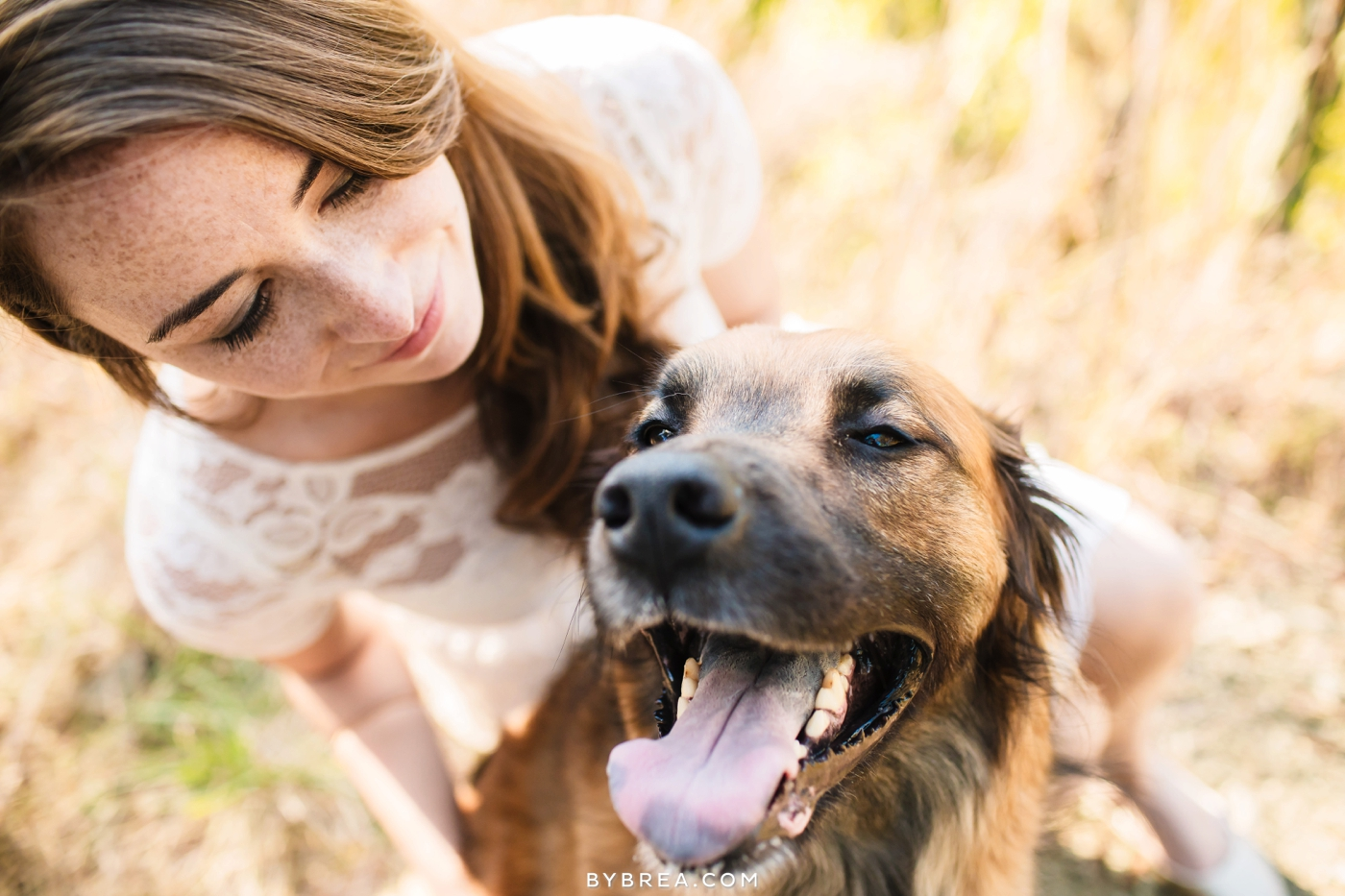 Baltimore engagement photo woman and her smiling dog