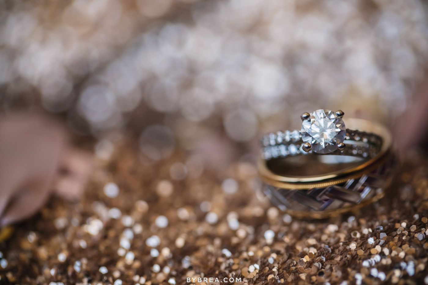 Baltimore wedding photo rings stacked on gold glitter