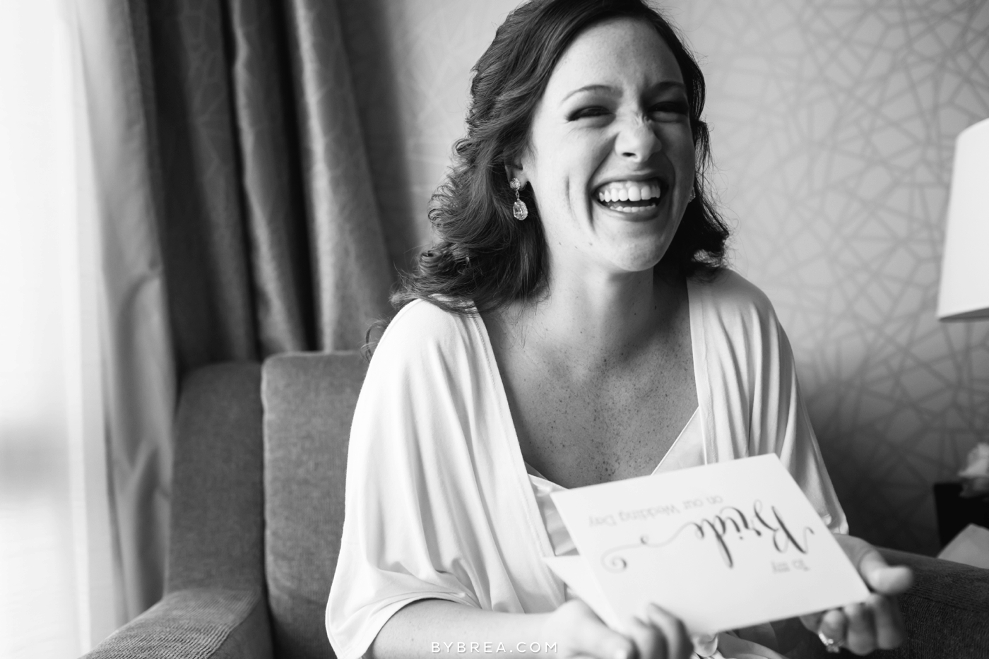 Baltimore wedding bride laughing while opening a gift