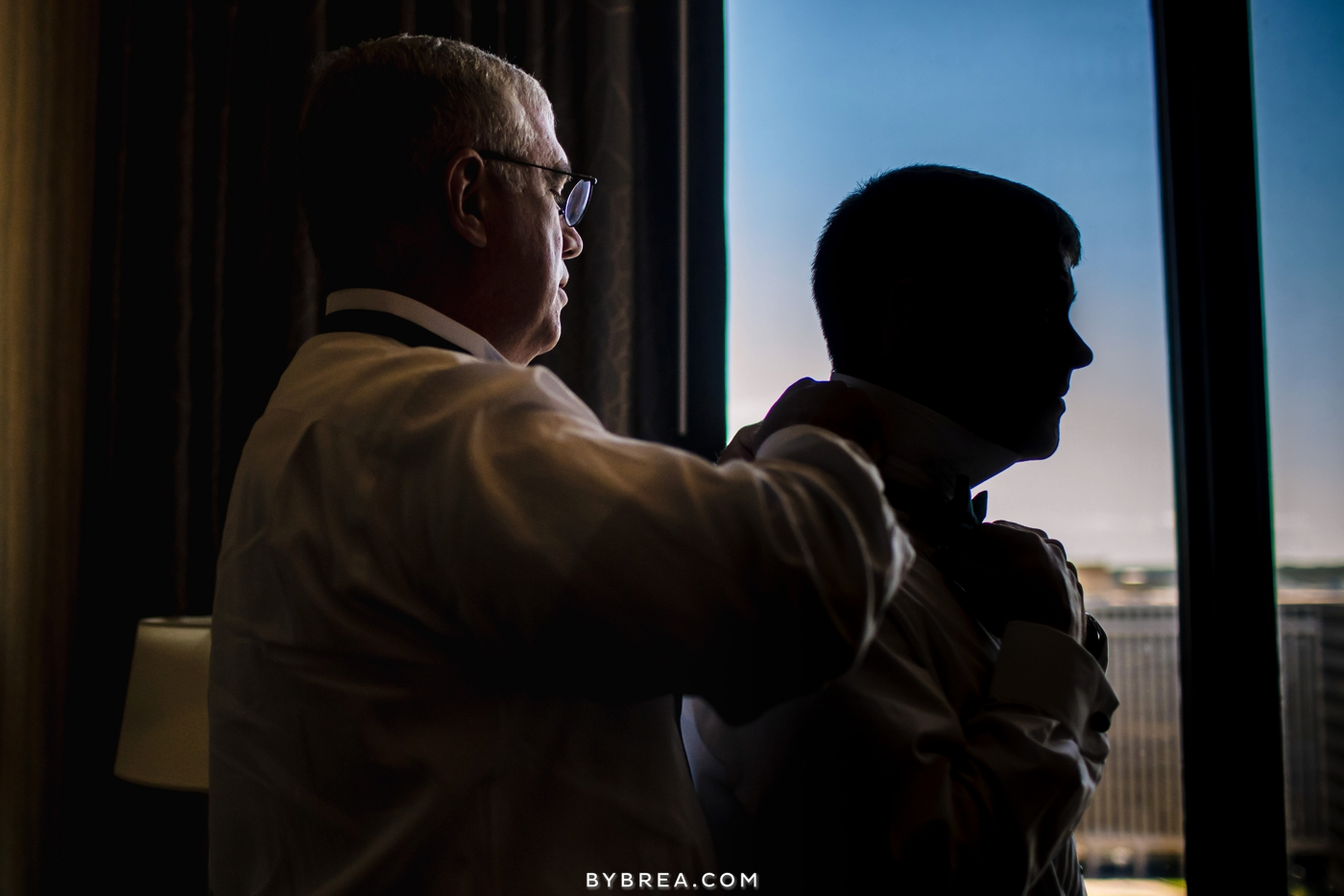 Baltimore wedding groom in silhouette getting ready