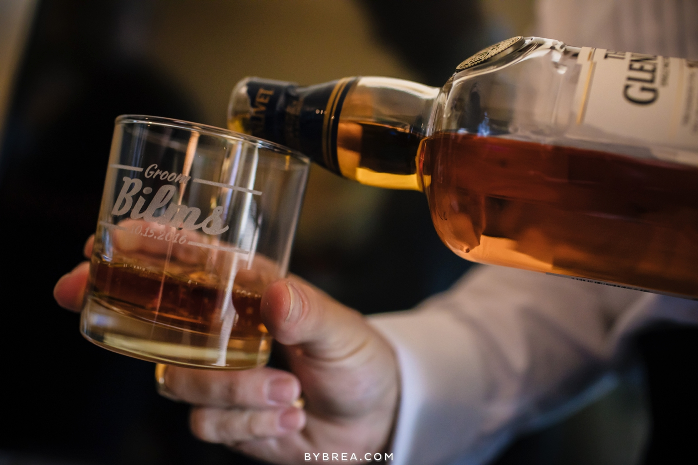 Baltimore wedding groom pouring liquor for a toast