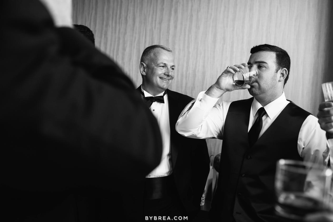Baltimore wedding groomsmen drinking their toast
