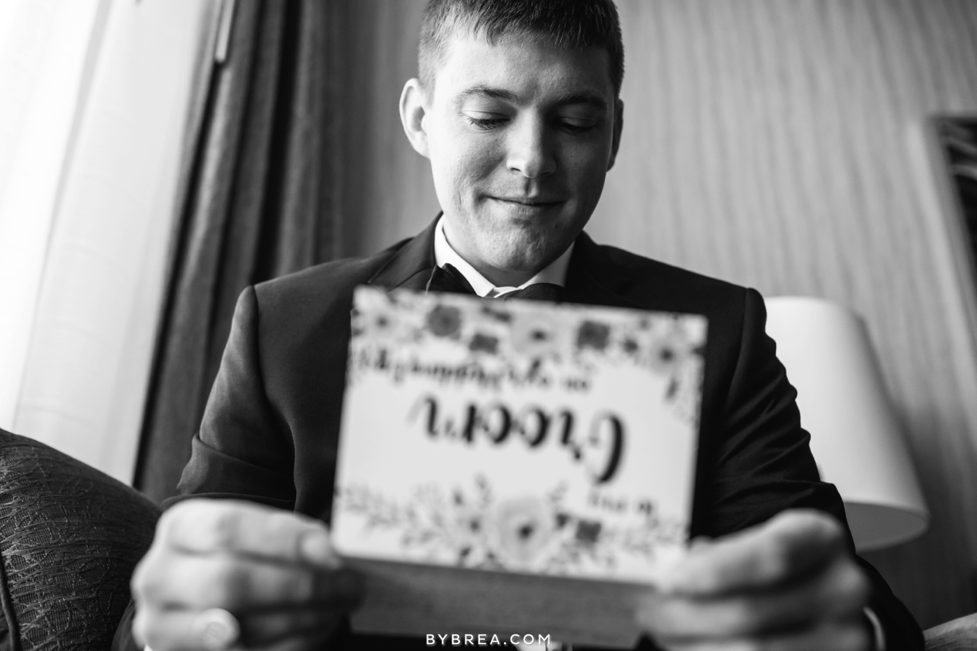 Baltimore wedding close up of groom opening a card