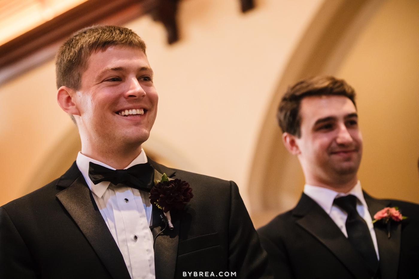 Dahlgren Chapel groom smiles as bride walks down aisle