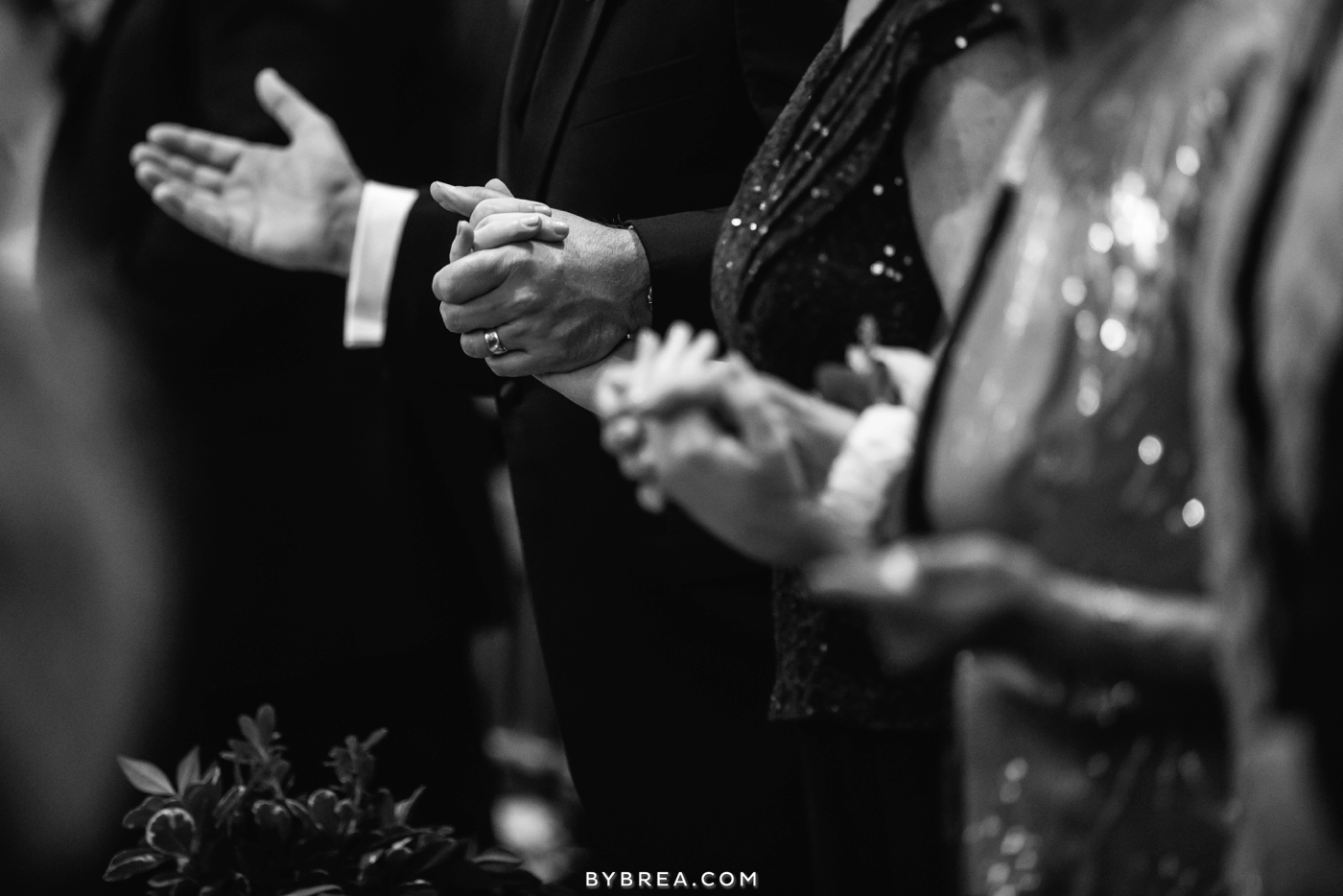 Baltimore wedding guests holding hands in prayer