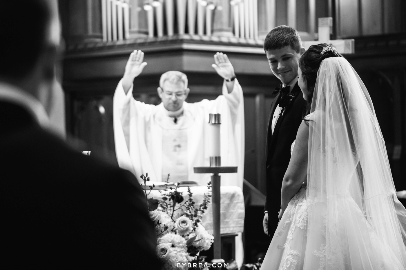 Baltimore wedding groom looks at bride during ceremony