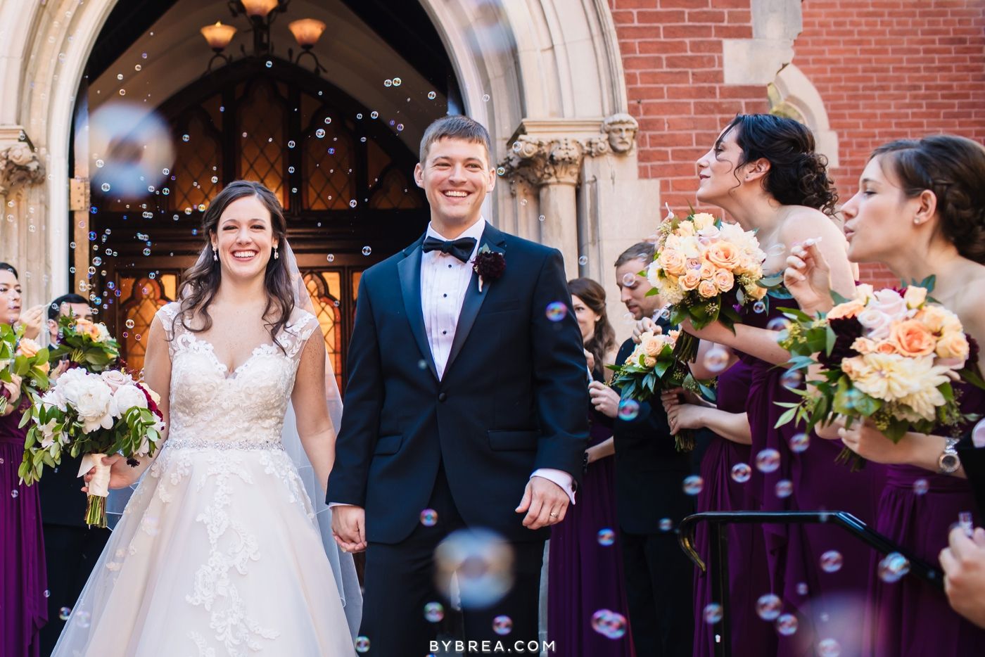 Bride and groom bubble recession out of Dahlgren Chapel