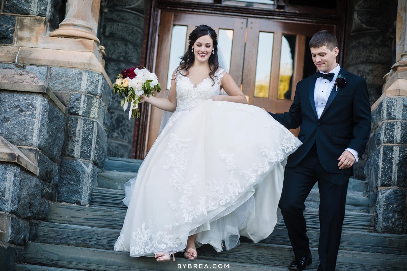 Dahlgren Chapel wedding groom helping bride down stairs