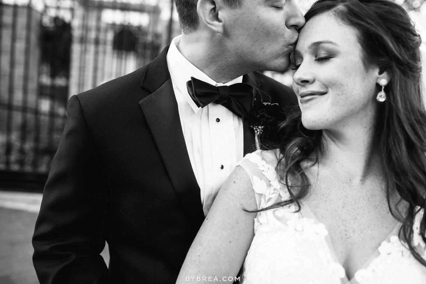 Baltimore wedding photo groom kissing bride's forehead
