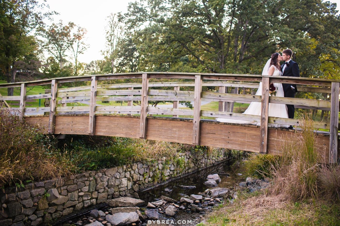 Baltimore wedding bride and groom kissing on bridge