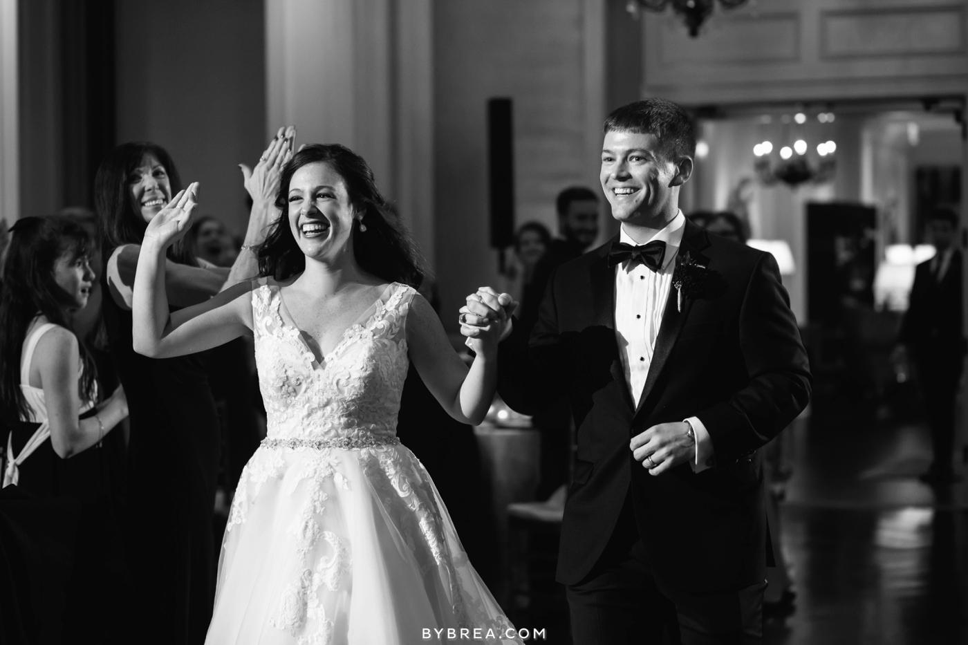 Baltimore wedding photo bride and groom enter reception