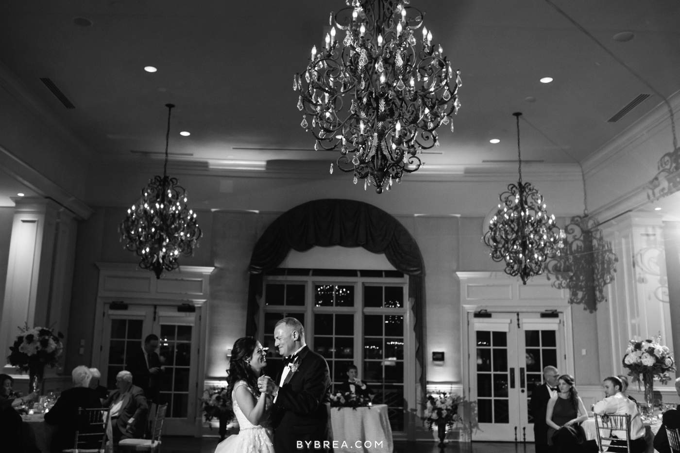 Army Navy Country Club bride and father dance under chandelier