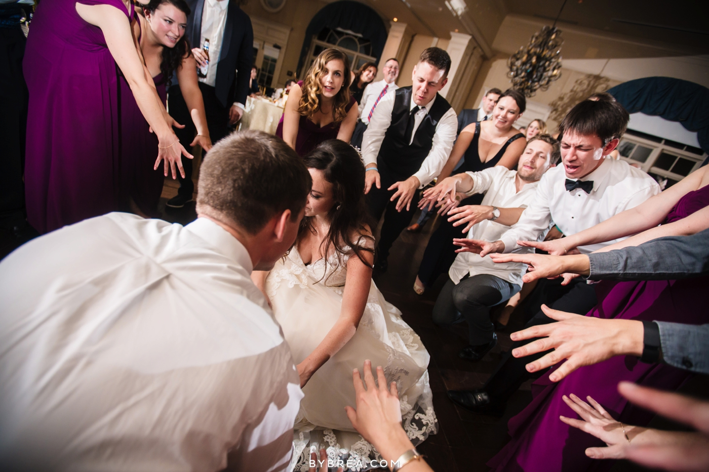 Baltimore wedding bride and groom dance in circle with guests