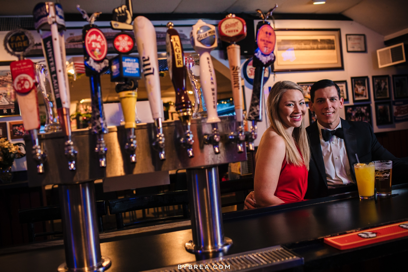 Christmas themed engagement photo beer taps sports bar fancy couple