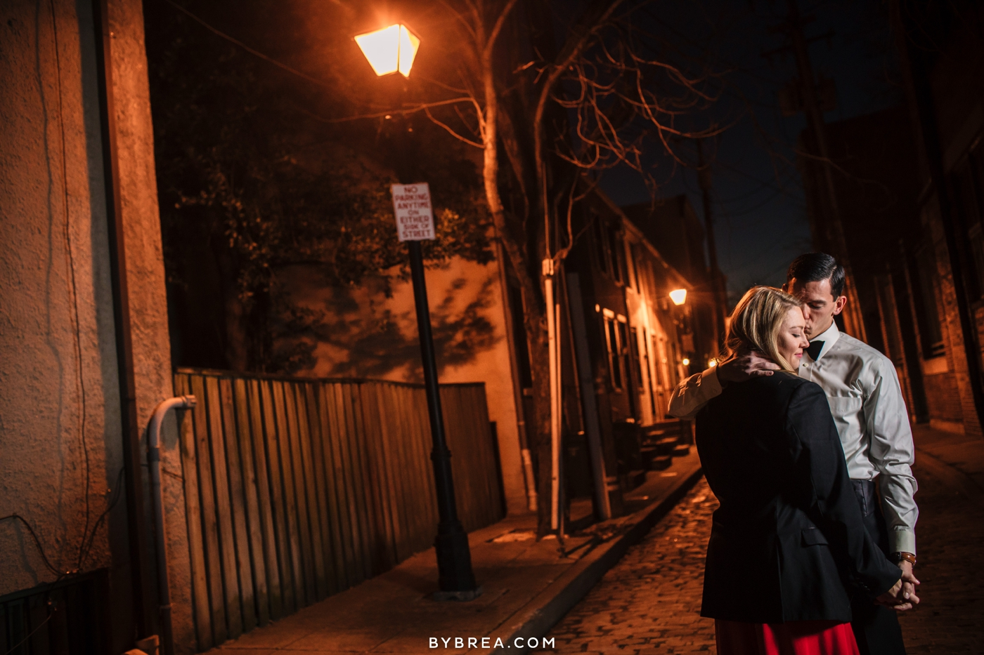 Christmas themed engagement session photo couple under street light