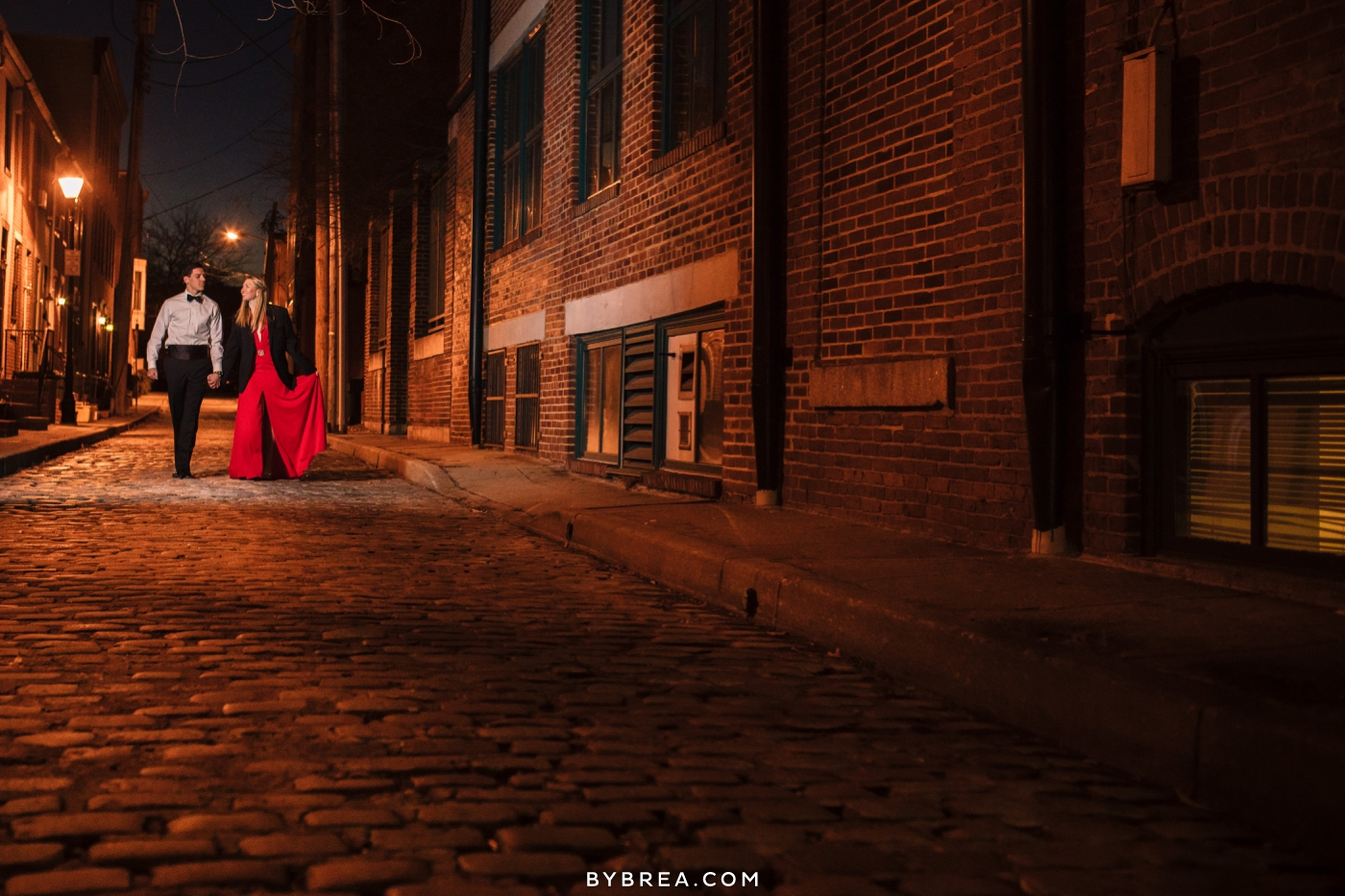Christmas themed engagement session photo tux gown walking downtown Baltimore