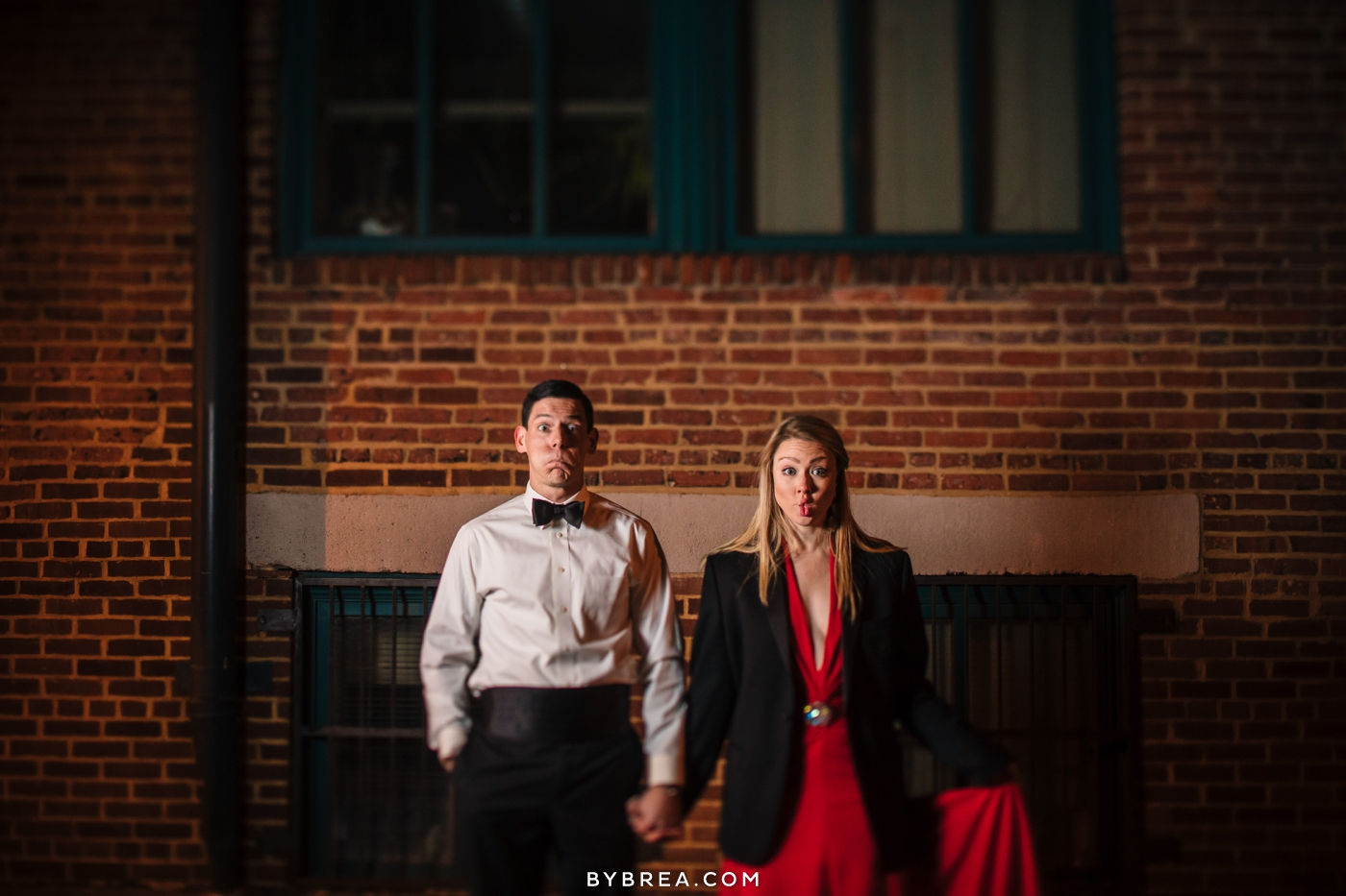 Christmas themed engagement session photo fancy couple funny faces portrait