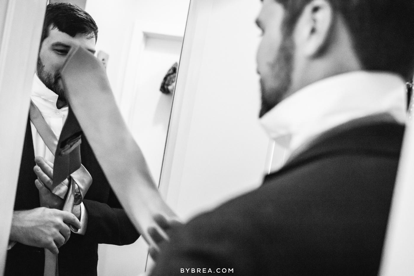 George Peabody Library wedding photo groom fastening tie
