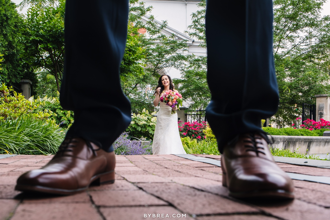 George Peabody Library wedding photo bride framed by groom's legs and feet first look