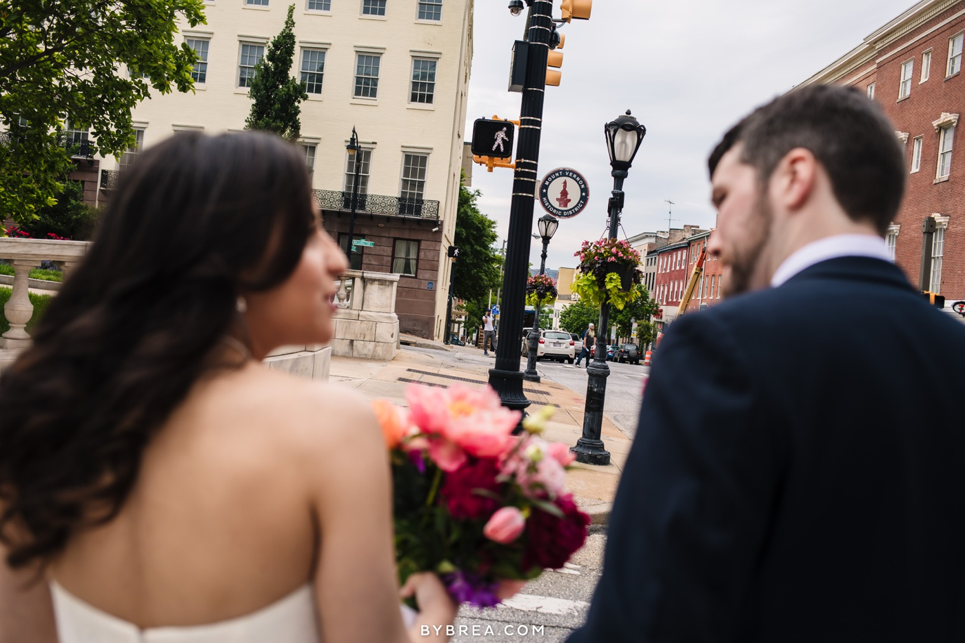 George Peabody Library wedding photo bride and groom with walk sign on street