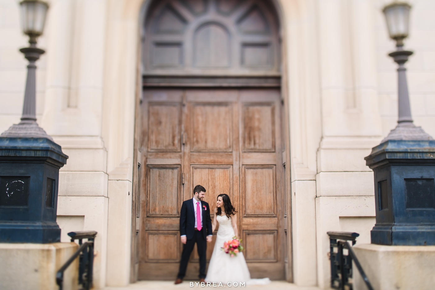 George Peabody Library wedding photo bride and groom portrait framed by doorway