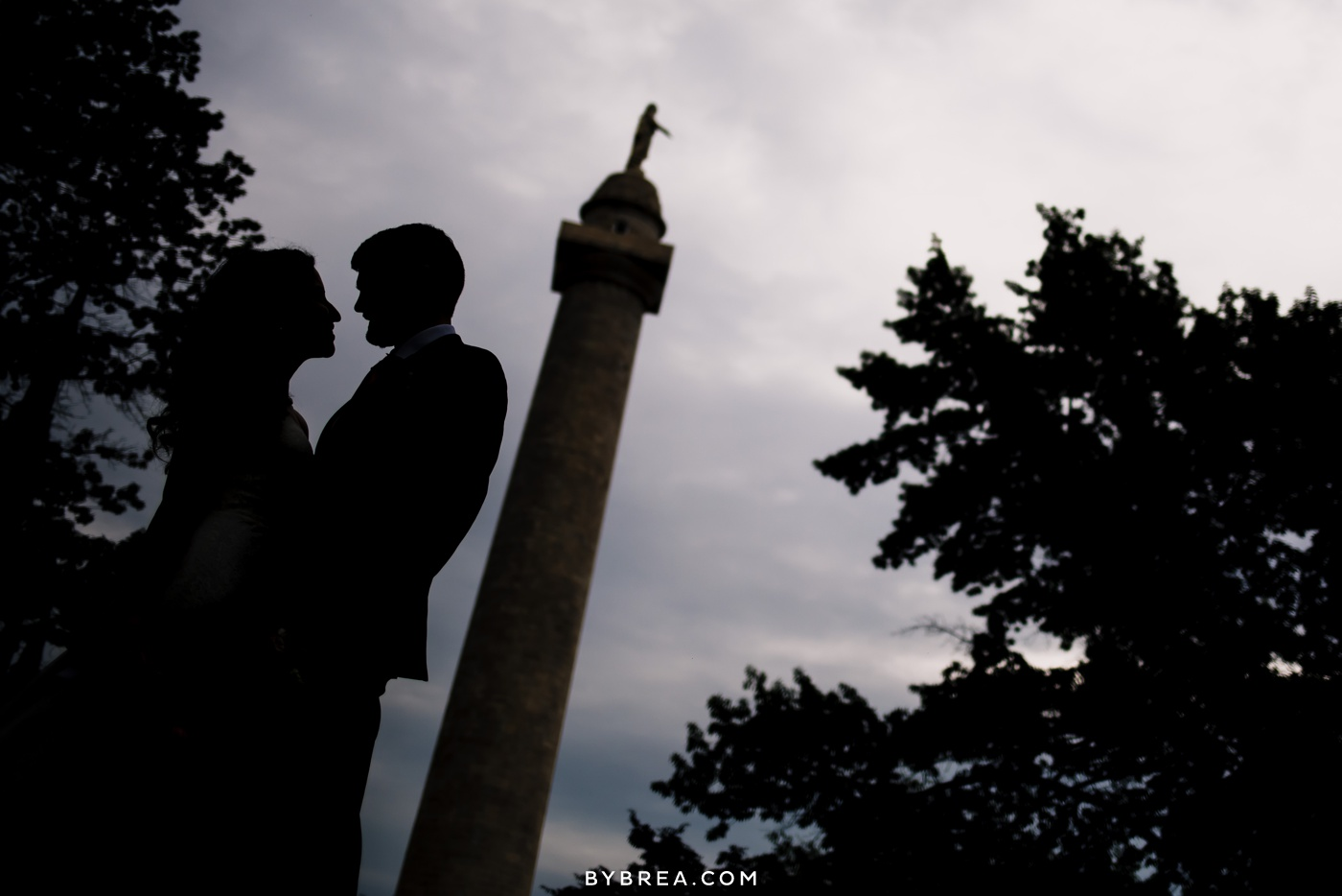 Baltimore wedding photo couple silhouette by statue