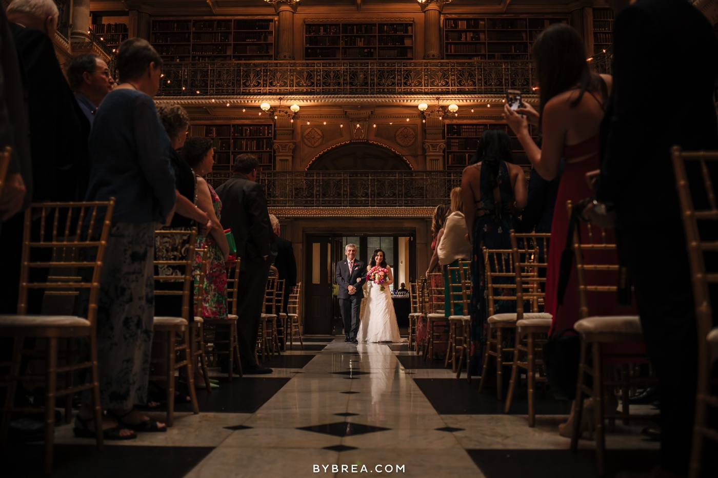 George Peabody Library wedding photo bride entering while guests stand