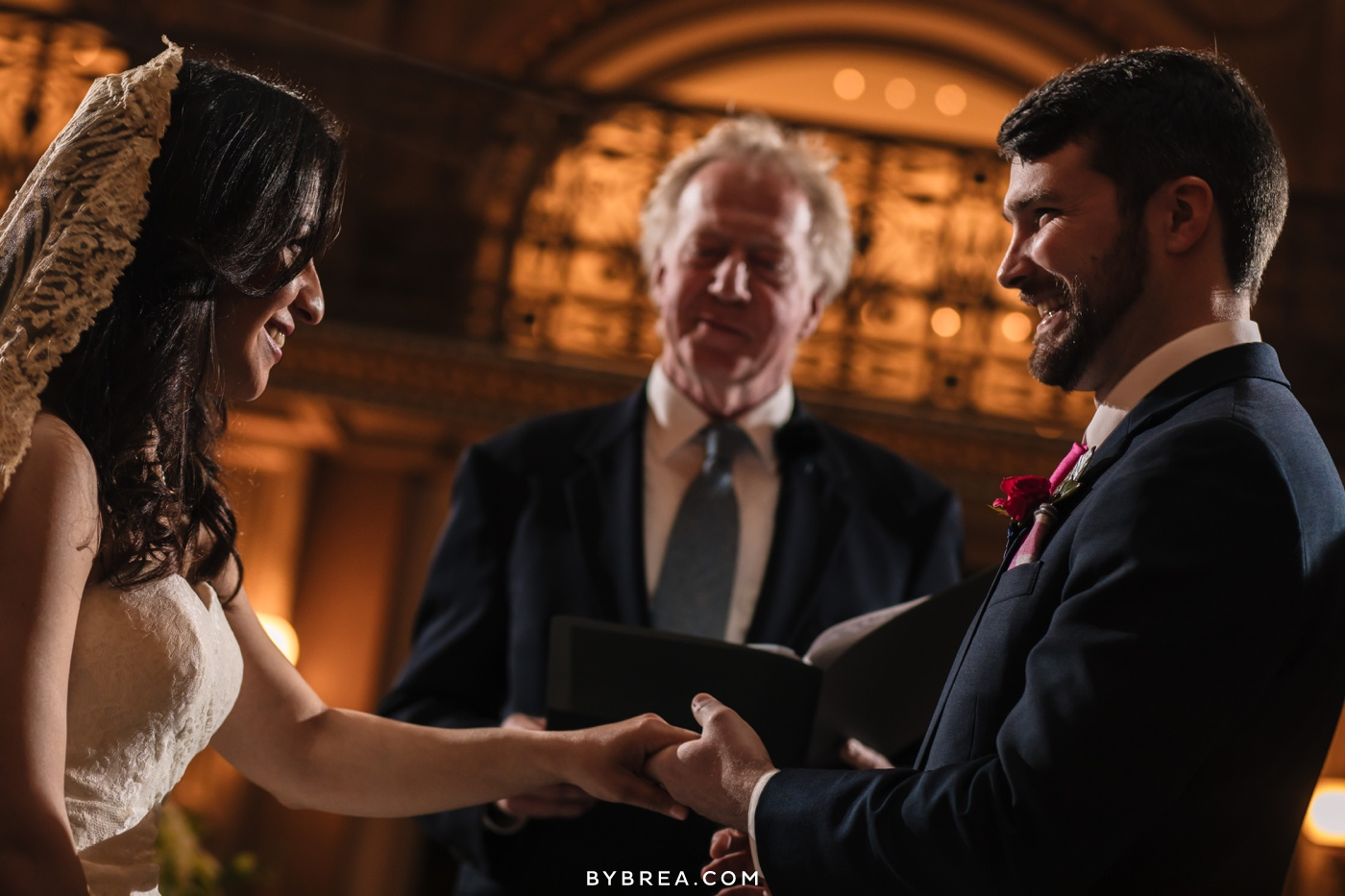 George Peabody Library wedding photo bride and groom exchanging rings