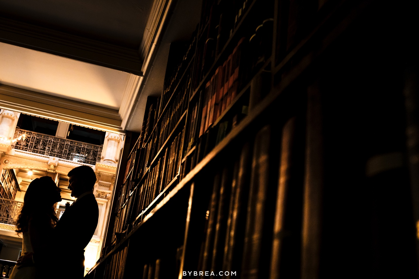 George Peabody Library wedding photo couple silhouette among books