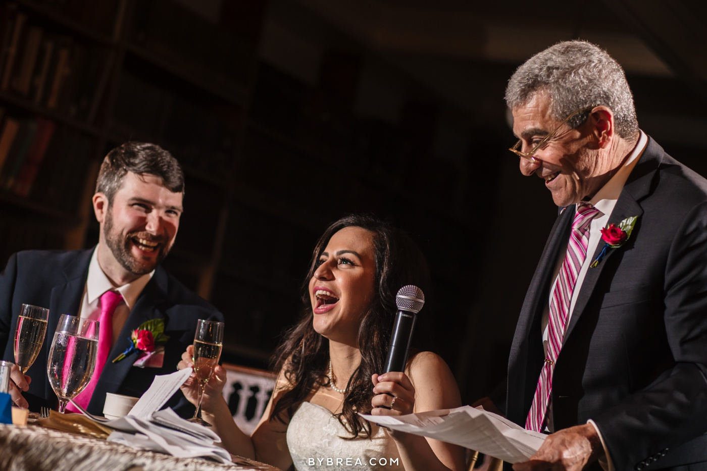 George Peabody Library wedding photo couple laughing as family member gives speech