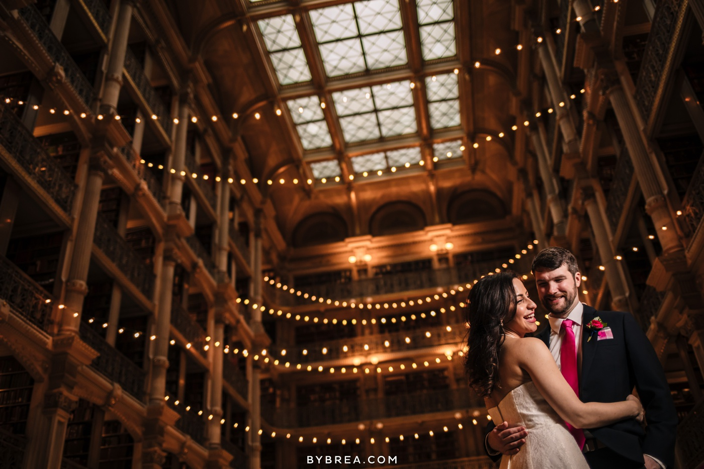 George Peabody Library wedding photo bride and groom dancing in main hall