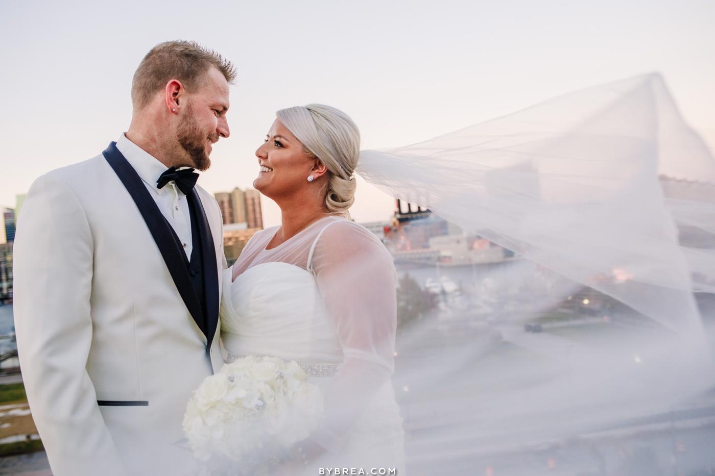Baltimore wedding photo of bride and groom Inner Harbor portraits