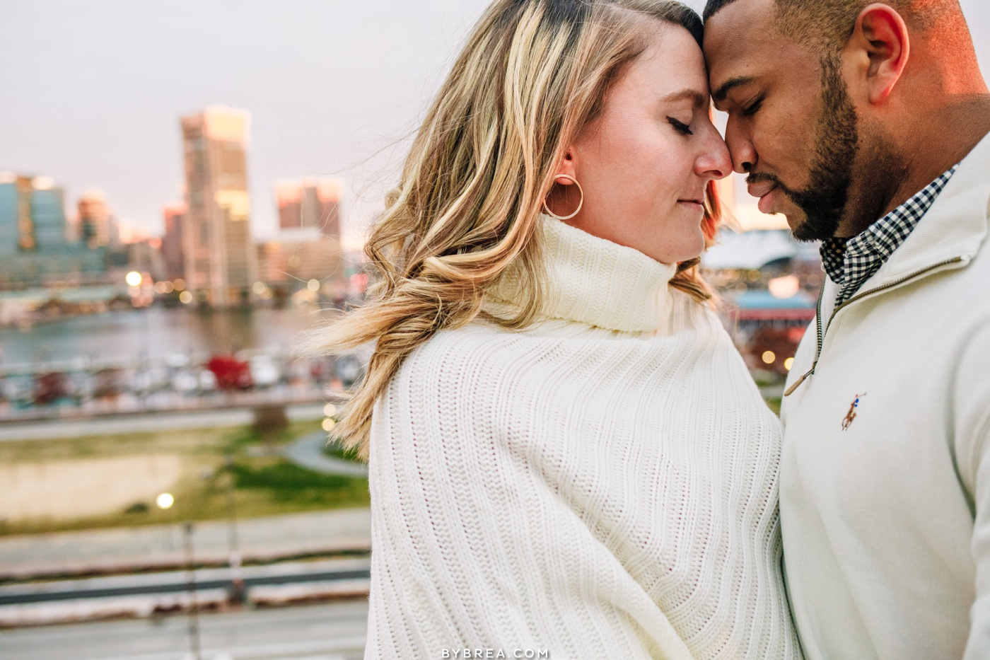 Engagement photo of couple on top of Fed Hill