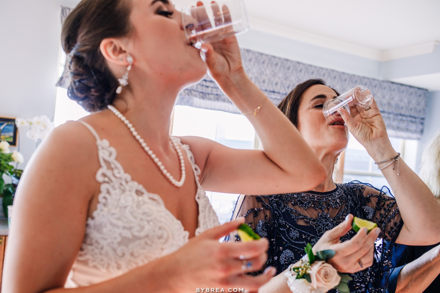 photograph of bride taking shots with mother Baltimore winter wedding