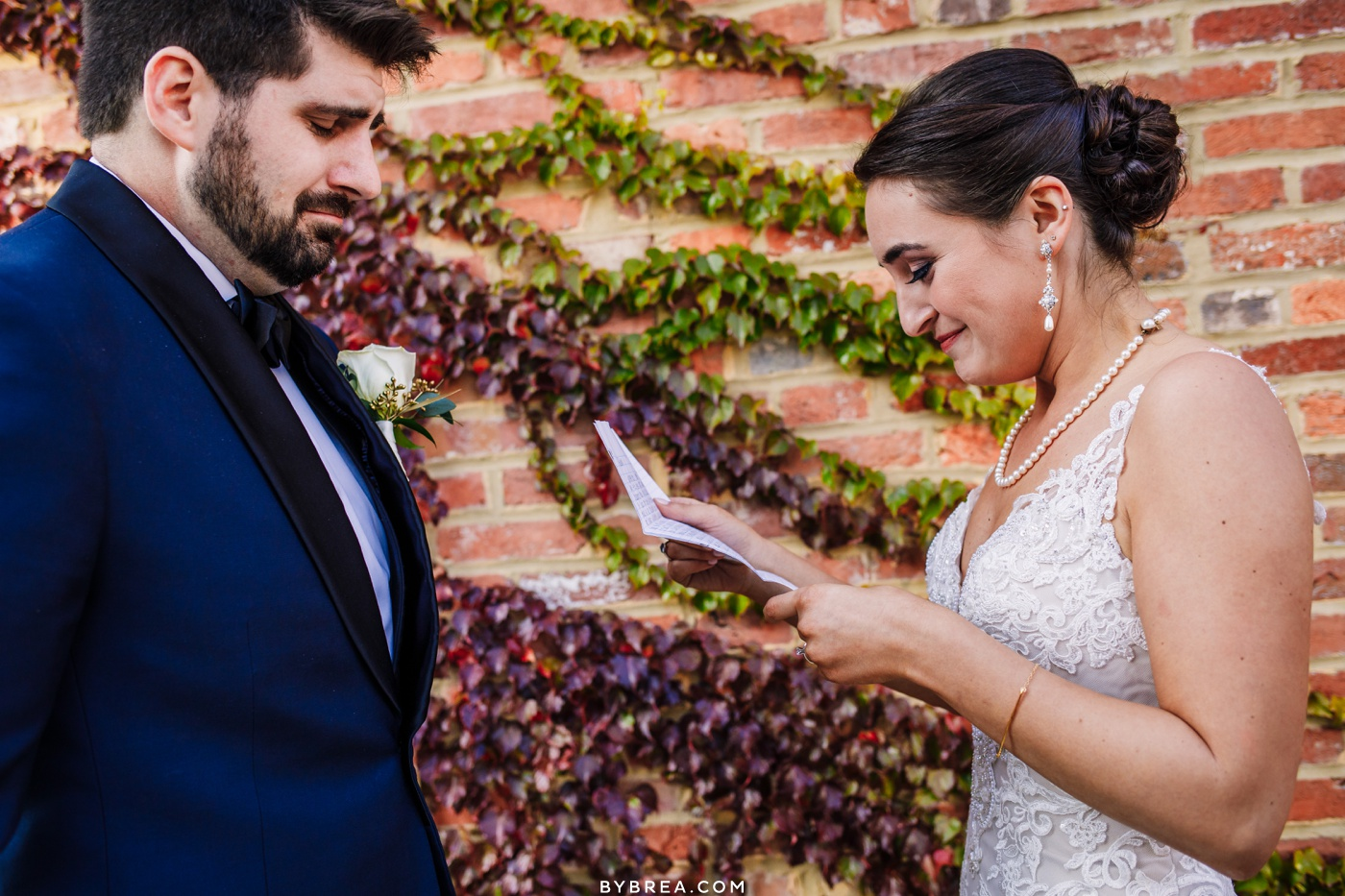 Photograph of bride and groom reading letters Baltimore wedding AVAM wedding