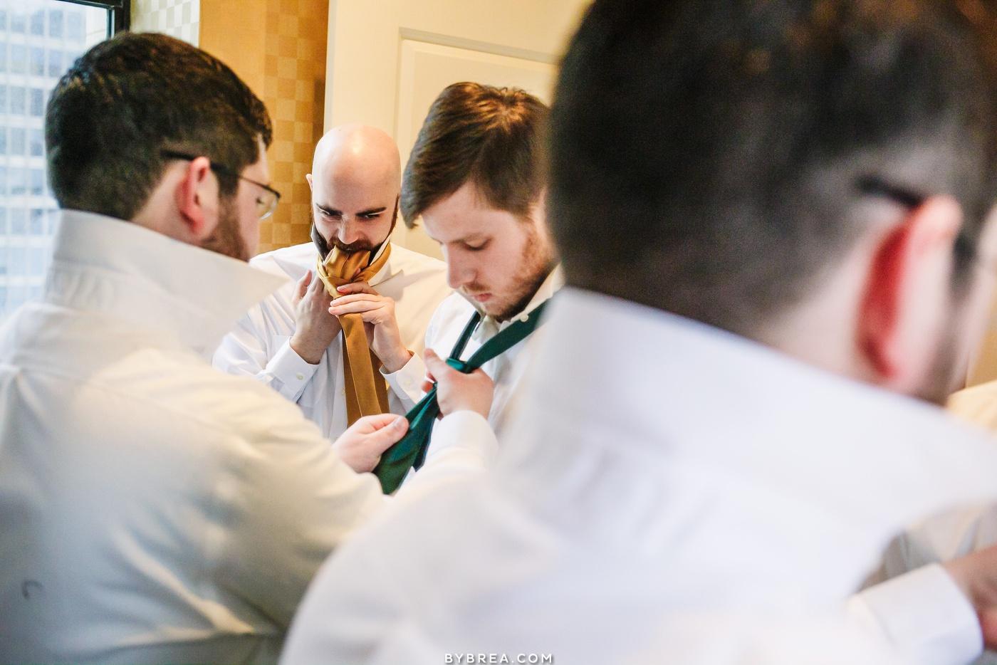 Photo of groomsmen getting ready Hotel Monaco Baltimore wedding