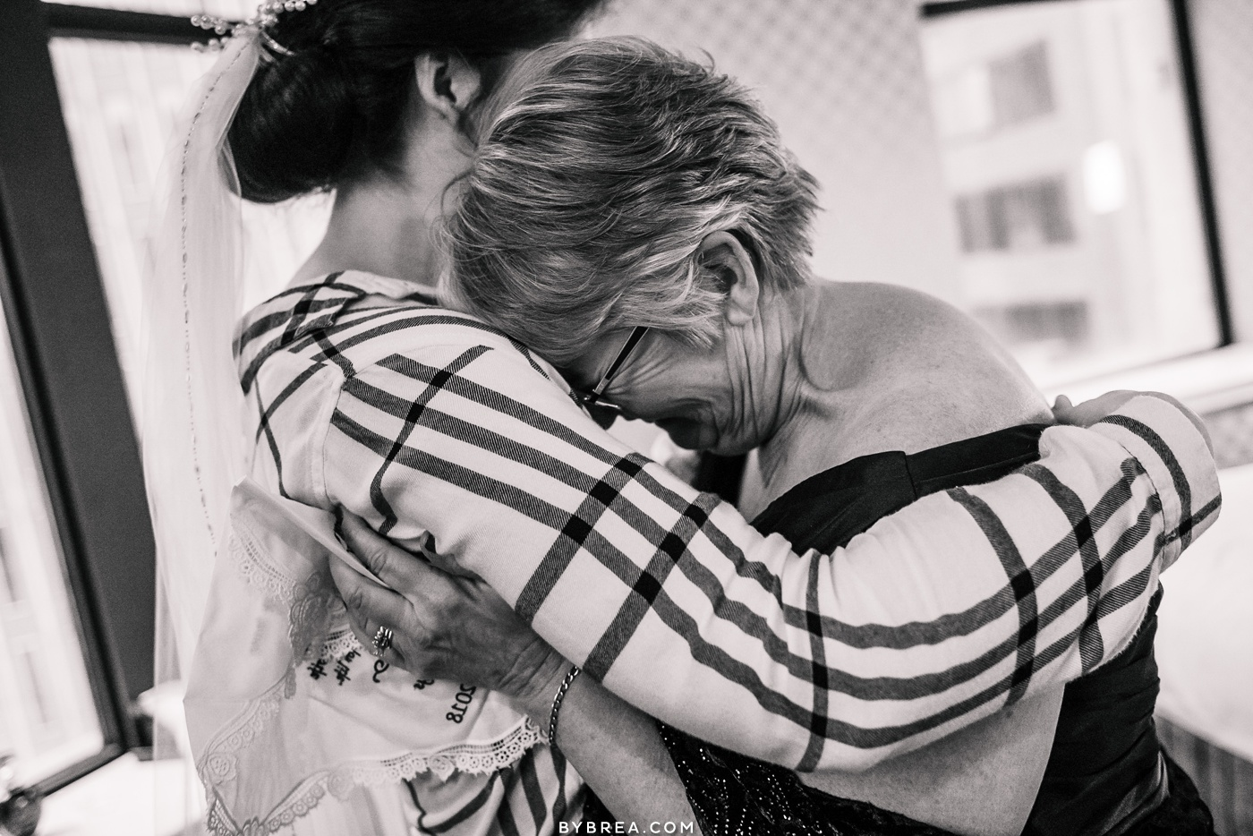 photograph of emotional moment between mother and bride Hotel Monaco Baltimore
