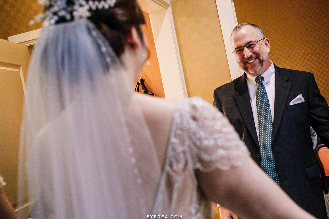 Father daughter first look at Kimpton Hotel Monaco Baltimore wedding