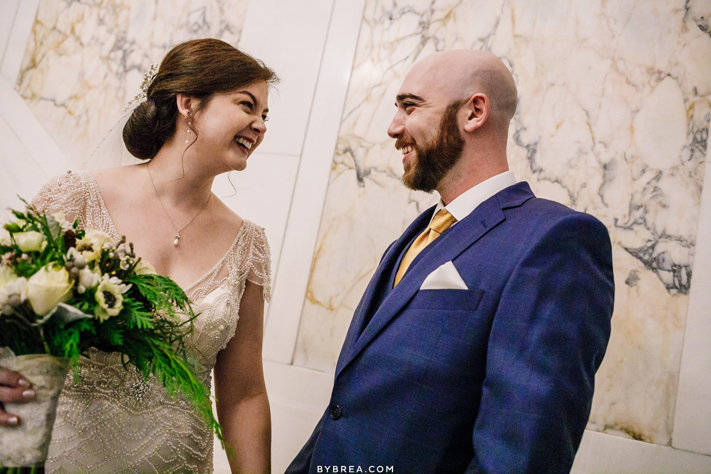 Photograph of bride and groom during first look Baltimore wedding